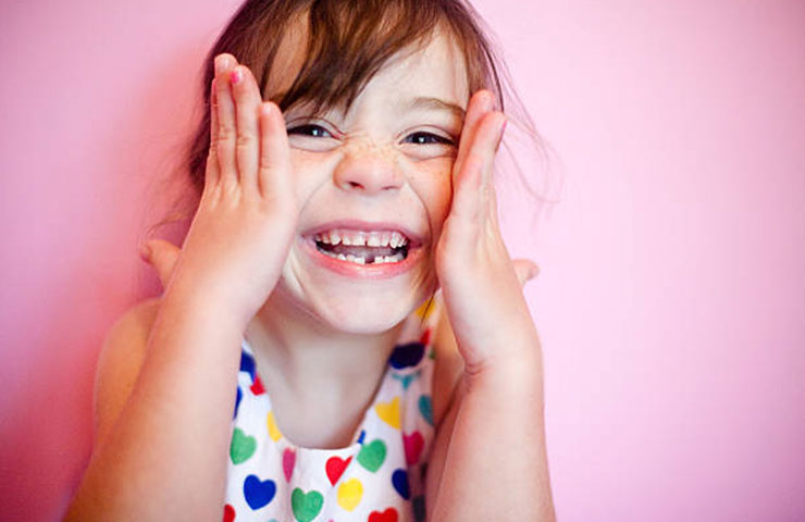 happy child with missing tooth